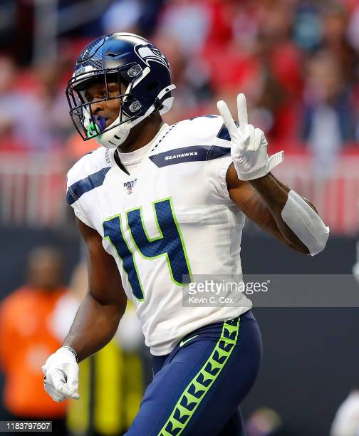 Metcalf of the Seattle Seahawks reacts after pulling in a touchdown reception against the Atlanta Falcons in the first half at MercedesBenz Stadium...
