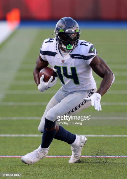 Metcalf of the Seattle Seahawks runs the ball after a catch against the Buffalo Bills at Bills Stadium on November 8, 2020 in Orchard Park, New York.