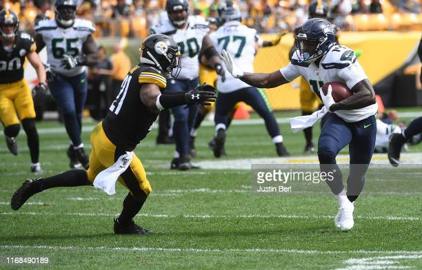 K Metcalf of the Seattle Seahawks runs upfield after a catch as Sean Davis of the Pittsburgh Steelers defends in the third quarter during the game at...