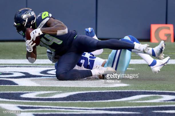 Metcalf of the Seattle Seahawks scores a 29 yard touchdown against Darian Thompson of the Dallas Cowboys during the fourth quarter in the game at...