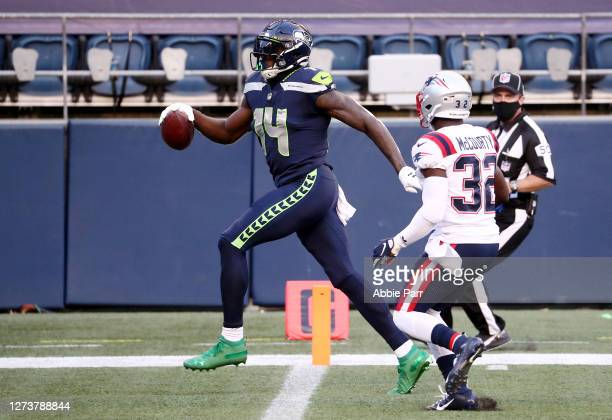 Metcalf of the Seattle Seahawks scores a second quarter touchdown against the New England Patriots at CenturyLink Field on September 20 2020 in...