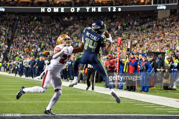 K Metcalf of the Seattle Seahawks scores on a 14 yard touchdown pass from Russell Wilson during the fourth quarter of the game against the San...