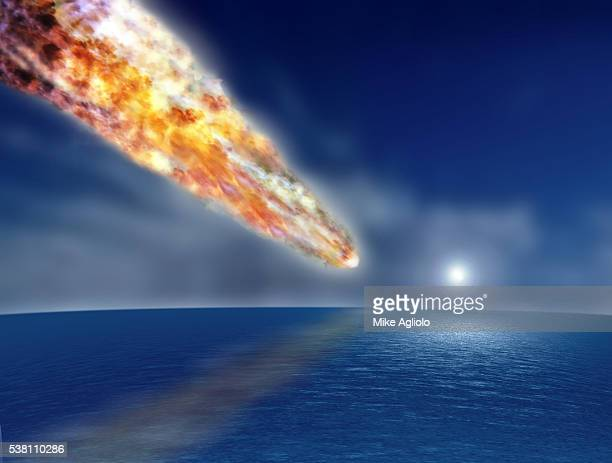 meteor about to hit the ocean - mike agliolo stock photos and pictures