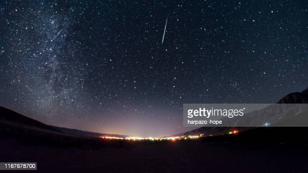 meteor above a small town in utah. - 自然現象 ストックフォトと画像