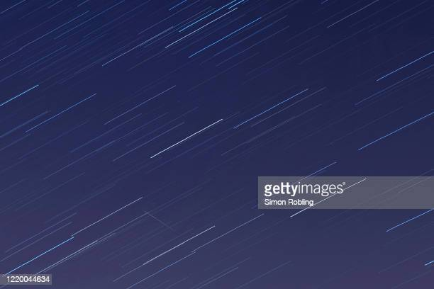Meteor crosses the sky illuminated under the stars on a clear night on April 21, 2020 in London, England. The clear skies created by the New Moon...