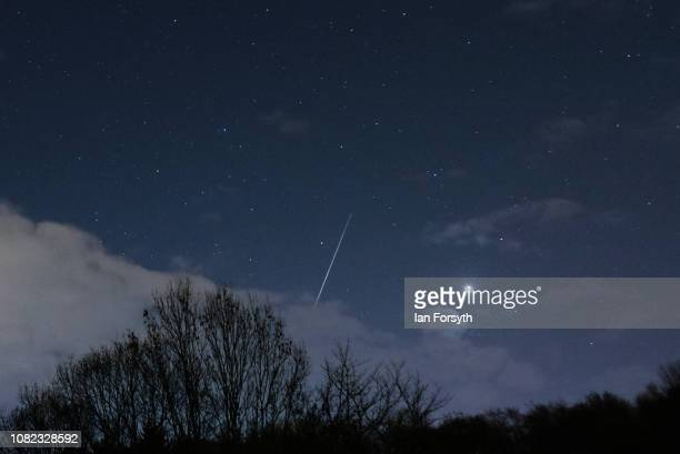A meteor from the Geminid Meteor shower streaks across the night sky past Sirius on December 14 2018 in Saltburn By The Sea United Kingdom The...