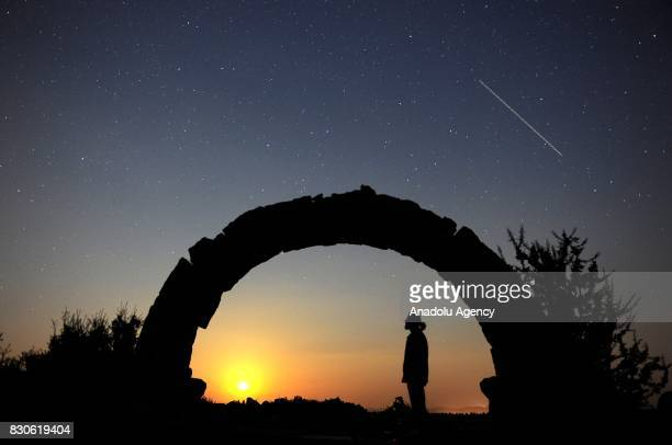 Meteor lights up the sky during perseid meteor shower above the ancient city of Blandus in Usak, Turkey on August 12, 2017.