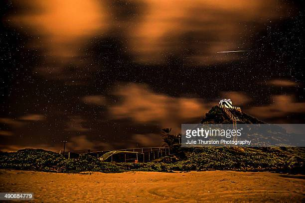 Meteor Shooting Star Flying Through the Night Sky Over Pyramid Rock Lighthouse at a Beach in Kailua Oahu Hawaii