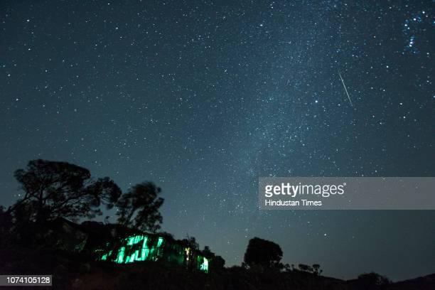 Meteor streaks across the night sky during the Geminid Meteor Shower over Harishchandra Fort on December 15, 2018 in Ahmednagar, India.