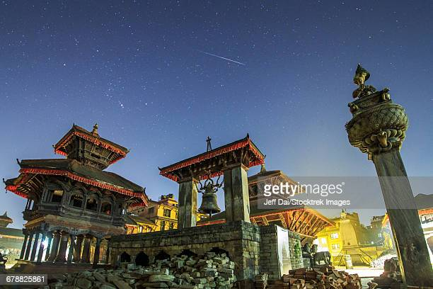 A meteor streaks the sky above Bhaktapur Durbar Square of Nepal.