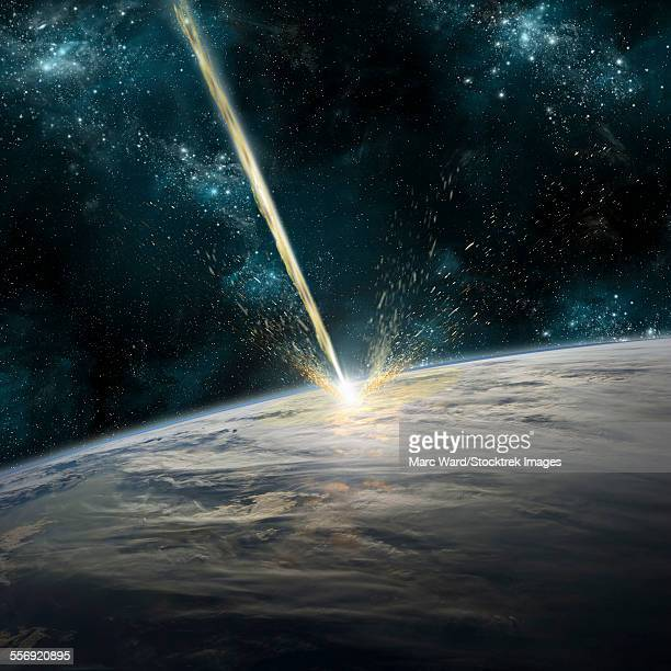 a meteor strikes earth. clouds cover an ocean area of the planet. planetary material is ejected back into space. - asteroide foto e immagini stock