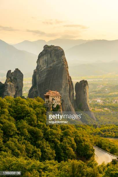 meteora monasteries at sunset, greece - greek orthodoxy stock pictures, royalty-free photos & images