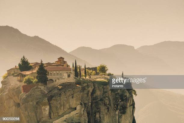 meteora, view at one of the monasteries in kalambaka, greek thessaly plain. - thessaly stock pictures, royalty-free photos & images
