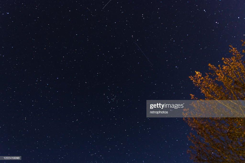 meteorite and stars in the night : Stock Photo