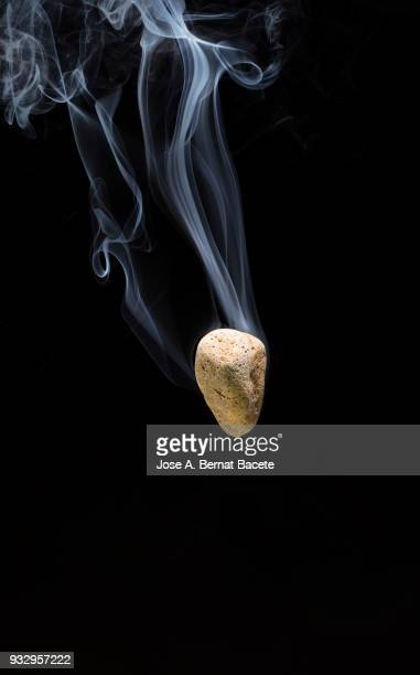 Meteorite,  rock or stone of fire with a stela of smoke that falls down down on a black background. Spain
