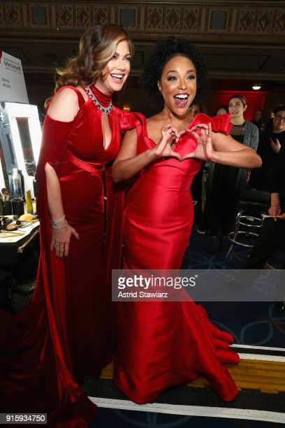 Meteorologist Ginger Zee and actor Lynn Whitfield prepare backstage at the American Heart Association's Go Red For Women Red Dress Collection 2018...