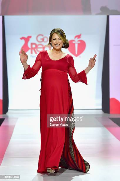 Meteorologist Ginger Zee prepares backstage at the American Heart Association's Go Red For Women Red Dress Collection 2018 presented by Macy's at...