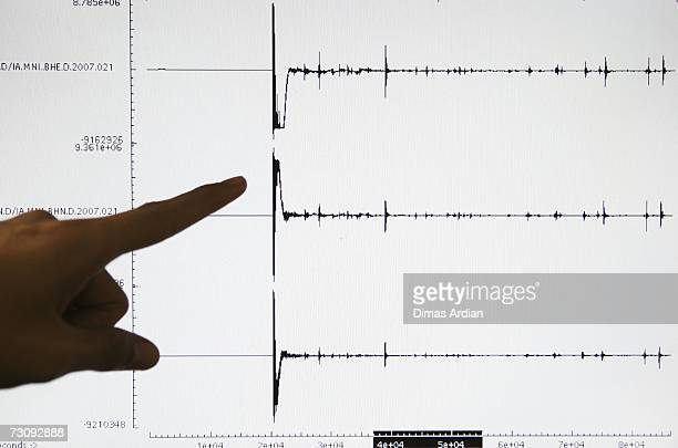 Meteorology and Geophysics Agency officer points to a screen graphic at the BMG office of a 6.5-magnitude earthquake that struck North Sulawesi...