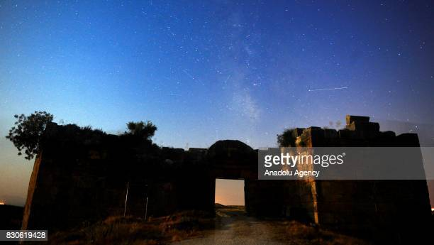 Meteors light up the sky during perseid meteor shower above the ancient city of Blandus in Usak, Turkey on August 12, 2017.
