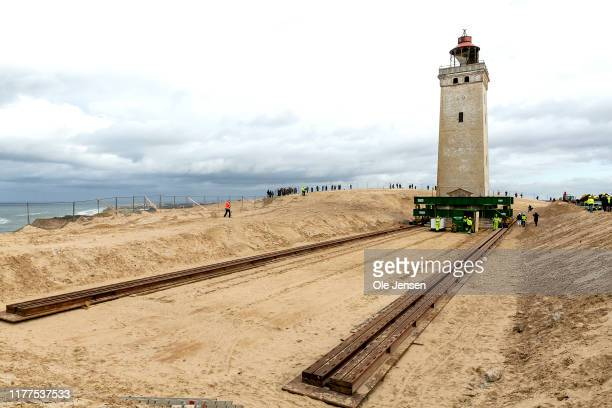 Meter high and 1.000 tons historical lighthouse built in stone at the northern Danish west coast is put on rollerblades and moved 80 meters inland...