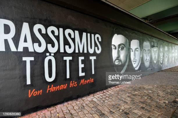 Meter long street art mural to commemorate the nine victims of the 2020 Hanau shooting spree at Friedensbruecke bridge is seen on June 19, 2020 in...