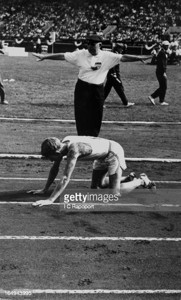 10000 meter runner Bob Soth collapses with only three laps to go during the USA versus the USSR track meet at Franklin Field on June 18 1959 in...