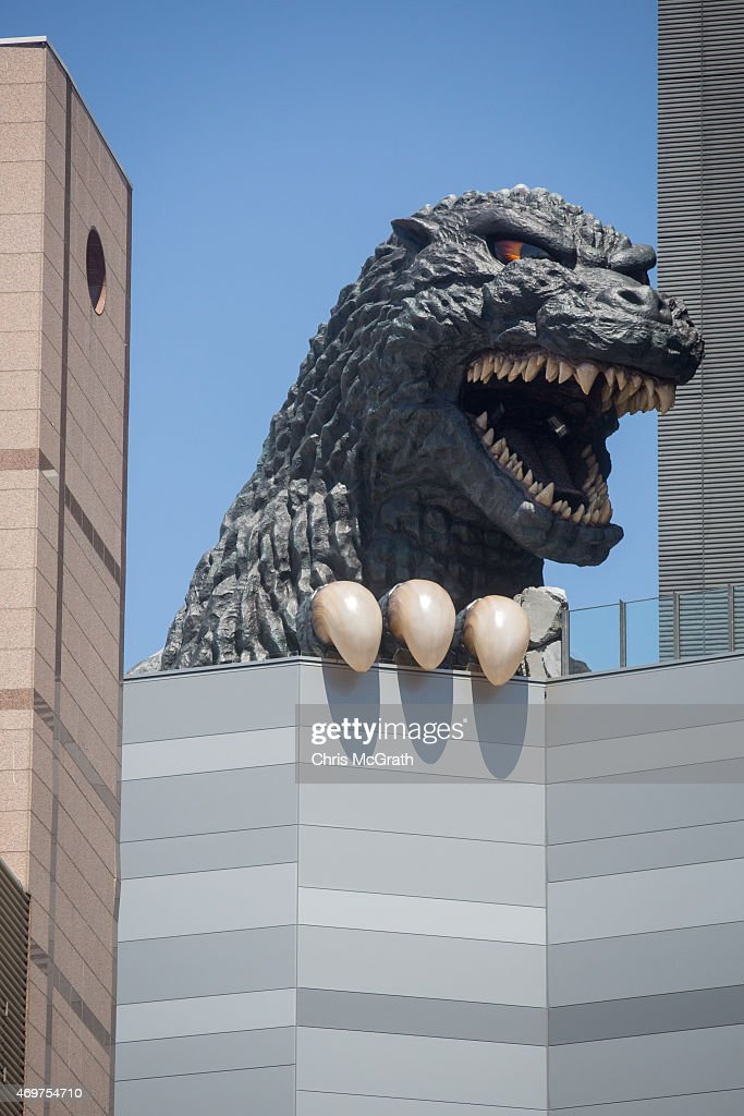 A 12 meter tall Godzilla replica head is seen on the 8th floor terrace of the Hotel Gracery Shinjuku on April 15, 2015 in Tokyo, Japan. The Godzilla replica, based on the original 1954 film is the main attraction of a new commercial complex containing a movie theatre, hotel and restaurants situated in the Kabukicho, red light district of Shinjuku and will be opened on April 17th. Along with the replica head the hotel also has six Godzilla view rooms with windows looking directly onto Godzilla, and one Godzilla themed room containing a man-sized Godzilla statue as well as a large Godzilla claw over the beds.