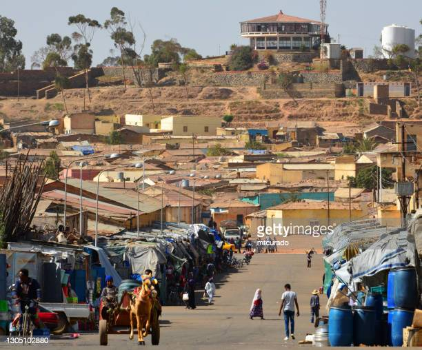 metera street and the cherhi recreation center, asmara, eritrea - asmara stock pictures, royalty-free photos & images
