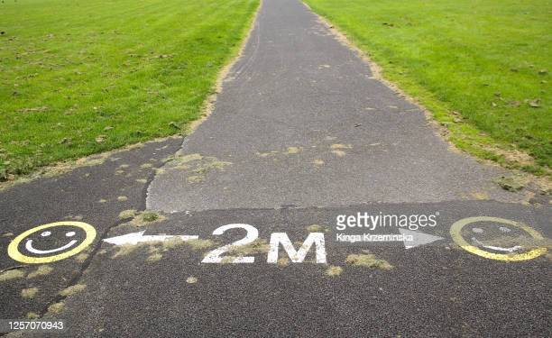 2 meters distance sign in the park - ireland stock pictures, royalty-free photos & images