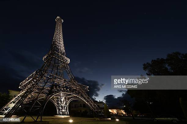 A 26 meters hight replica of the Eiffel tower made by Greek doctor and sculptor Harris Fournarakis stands at a square of the entrance of Filiatra...