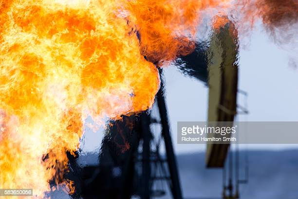 methane burn - flare stack stock photos and pictures