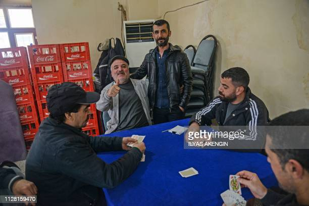 Metin Arslan a muhtar candidate for the historical Sur district, a UNESCO world heritage site, poses in a cafe in the Kurdish-majority city of...