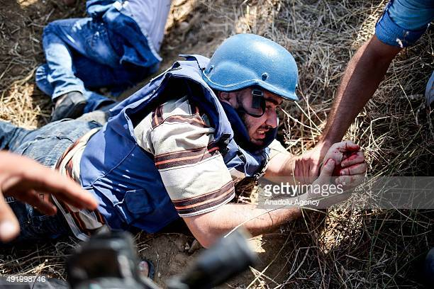 Metin Yuksel Kaya an Anadolu Agency photographer is seen after he was injured by Israeli gunfire while covering clashes between Palestinians and...