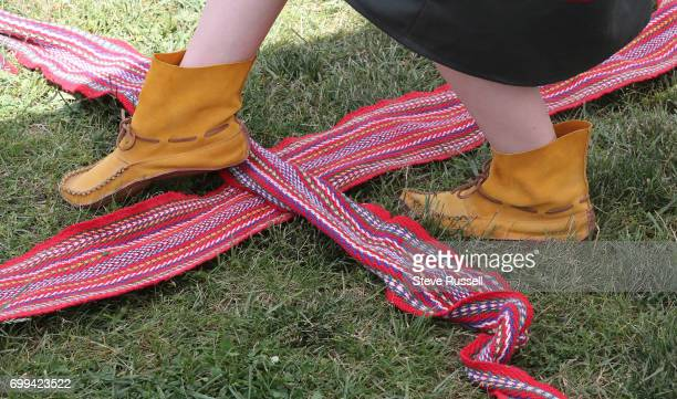 TORONTO ON JUNE 21 Metis dancer performs the sash dance National Aboriginal Day and Indigenous Arts Festival at Fort York in Toronto The festival...