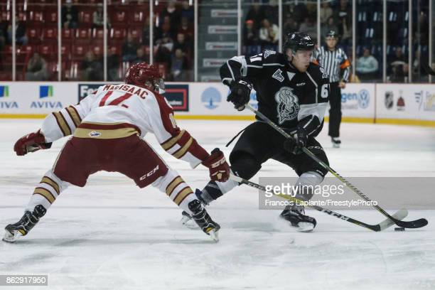 Metis Roelens of the Gatineau Olympiques carries the puck past the blue line against Domenic Malatesta of the Acadie-Bathurst Titan on October 18,...