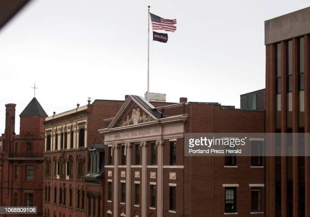 A #MeToo flag flies below an American flag near Sen Susan Collins office in Portland on Thursday November 29 2018