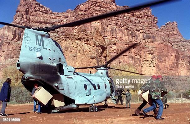 MEtoysfortots#11220RL–Supai Az– Members of the Flagstaff Marine Corps League San Francisco Peaks Detachment unload toys from a CH–46 Marines...