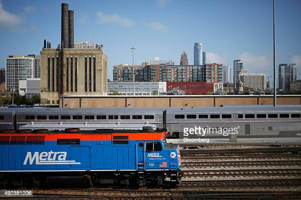 A Metra commuter train passes in front of Amtrak Superliner passenger cars outside Union Station in Chicago Illinois US on Wednesday Oct 7 2015 The...