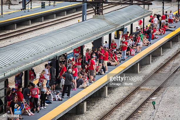 Metra commuters wait for Metra Electric train at Museum Campus station after celebrating the Chicago Blackhawks' Stanley Cup championship on Thursday...