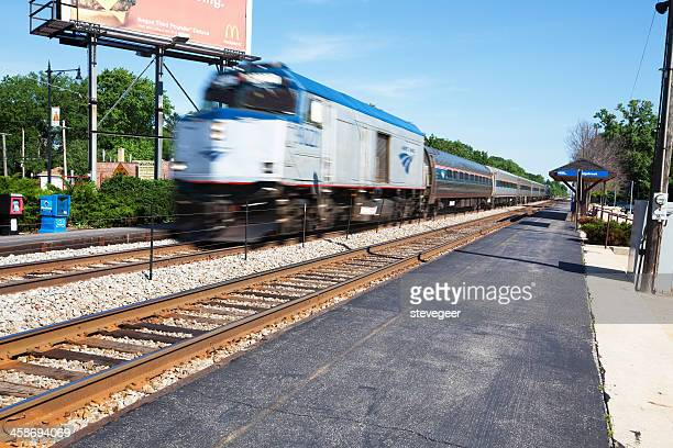 metra train moving past edgebrook station, chicago - metra train stock photos and pictures