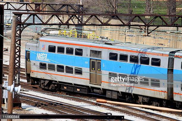 Metra train pulls into the station as photographed from a bridge over the Metra Station in Chicago Illinois on APR 13 2011