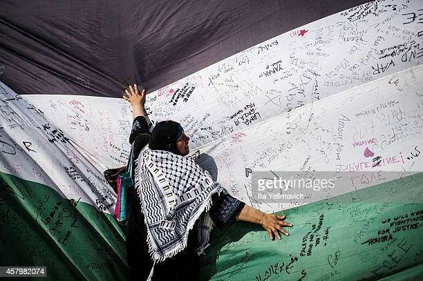 66 metre Palestinian flag symbolical of the 66 years since the establishment of the state of Israel and the beginning of occupation of the West Bank...