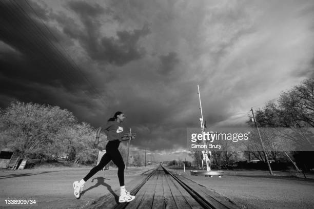 This image has been converted to black and white), 800 metre runner Diane Modahl of Great Britain doing warm weather running during training on the...