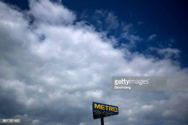 A Metro AG logo sits on a sign outside the company's wholesale food distribution depot in Weiterstadt Germany on Wednesday April 25 2018 Metro AG the...