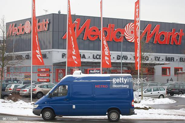 A Metro AG van passes one of the group's MediaMarkt stores in Duesseldorf Germany on Tuesday Jan 12 2010 Metro AG Germany's largest retailer said...