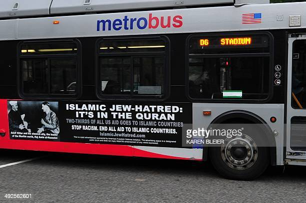 A Metro bus featuring a controversial ad drives on a street in Washington DC on May 21 2014 Busads linking Islamic Jewhatred Islam with Adolf Hitler...