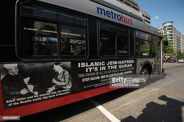 A Metro bus featuring a controversial ad drives on a street in Washington on May 23 2014 Bus ads linking Islamic Jewhatred Islam with Adolf Hitler...