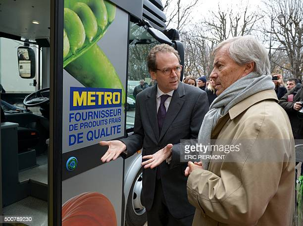 Metro Cash & Carry France CEO, Benoit Feytit speaks with Chairman and CEO of French industrial group Bollore, Vincent Bollore during the launch of...