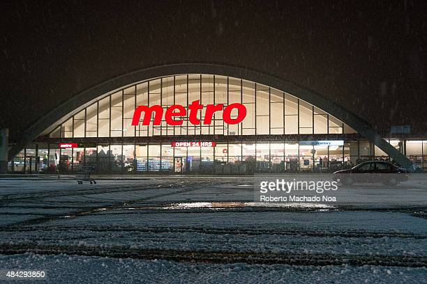 Metro Grocery Store during a Snowstorm at night The parking lot is covered with snow Metro is a food retailer operating in the Canadian provinces of...