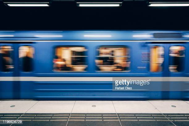 metro in motion - subway platform stock pictures, royalty-free photos & images